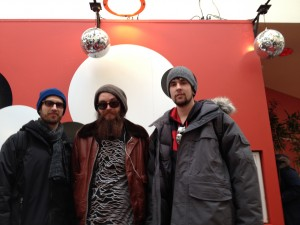 Caleb Peyman Michael Nowlin and Tyler McDowell at the Sundance Box Office striking a celebrity pose.