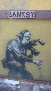 Banksy came to Sundance and left his artwork on the side of a building.